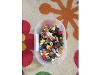Box of Legos with figures