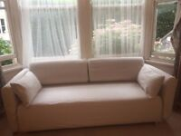 Attractive adaptable ikea sofa / comfortable single bed.