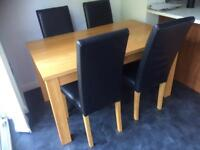Oak dining table and 4 black leather chairs