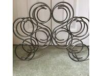 Decorative Metal wine rack holds 8 bottles