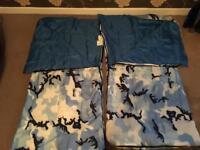 2 blue children's sleeping bags