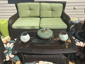 Beautiful love seat with  cushions and two tier coffee table
