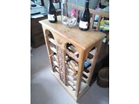 OLD PINE WINE RACK WITH A CARVED PANEL