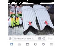 Cricket pads( youth ) size 5 1/2 adidas cricket shoes