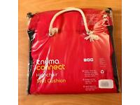 Red, never used Knuma high chair cushion