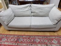 Marks & Spencer three seater sofa with two armchairs in a natural coloured linen fabric.