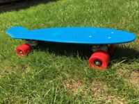 Australian Penny Board - Blue with Red wheels never been used.