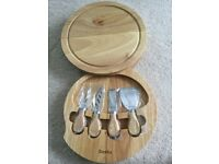 Denby cheese board with four cheese knives. Brand new.