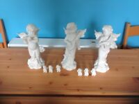 The angels are 9.5 inches high, and the cherubs are about an inch.