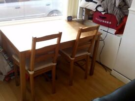 Table and 2 chairs.