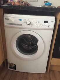 Washing machine used a handful of times, looks brand new!