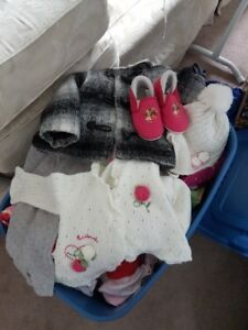 Box of girl clothes and shoes