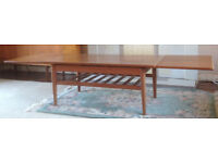 1960s Danish teak coffee table with two extending leaves and ladder magazine rack