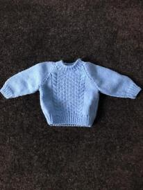 Hand knitted baby clothing