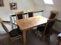 Solid Oak dining table and 6 Oak/leather chairs