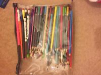 Pencil case full of pens and pencils