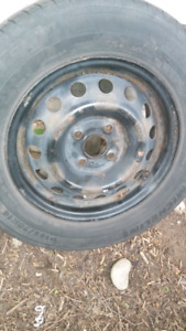 4X100 FULL SIZE SPARE RIM WITH TIRE..LOTS OF TREAD