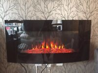 Electric wall mounted fire with remote control.