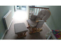 Nursing chair with matching footstool.