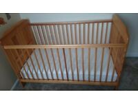 Wooden oak cot bed convertible to junior bed