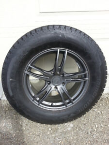4 Bridgestone Blizzaks DM-V2 on gunmetal grey Envy Rims