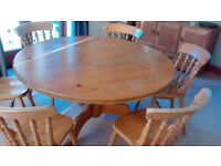 Circular pine dining table and 6 chairs
