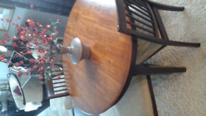beautiful walnut finish dining table and chairs.