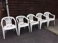 5 white plastic garden chairs