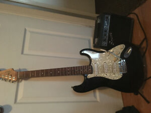 Black and white Squier strat fender