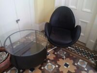black leather armchair and round coffee table can deliver