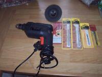 black and decker 400watt electric drill + accessories.