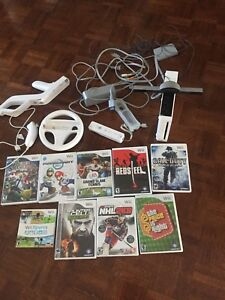 Wii w/ Accesories and Games