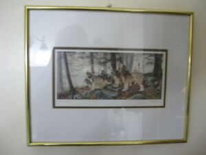 Wolves print in gold frame
