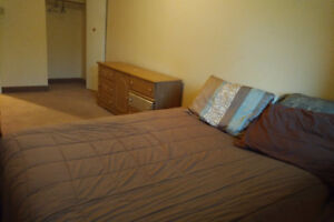 FURNISHED LARGE ROOM AVAILABLE FOR AUGUST. PARKING INCLUDED.
