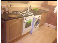 Kitchen units, oven and the hob.