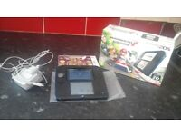 for sale we have a 2ds console comes with box, charger and is black and blue
