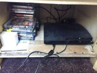 PS3 with 18 games two controllers 120gb