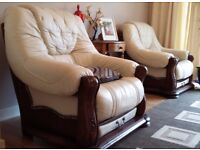 2 cream leater and wood armchairs