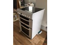 Freestanding Indesit cooker with ceramic hob and double oven