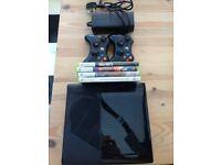 Xbox 360 E w/ 2 controllers + 4 games