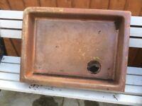 Old glazed earthenware sink
