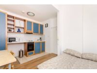 First floor self contained studio flat with open plan kitchen and en-suite shower/WC.