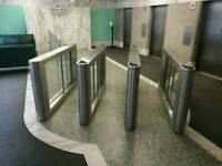 QUALITY USED GLASS TURNSTILE SECURITY ACCESS BARRIERS IN LONDON EC2R
