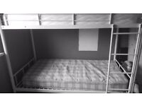 white metal frames bunk beds with mattresses