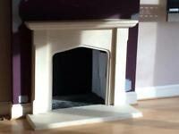 Limestone fireplace with hearth
