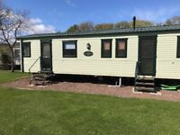 Static caravan for sale with double glazing & gas central heating, price reduced for quick sale