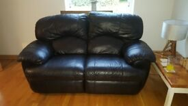 2 x two seater black leather sofas
