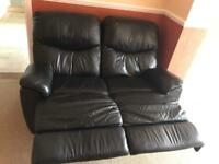 Black leather reclining double seat sofa