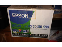 One scanner (Visioneer 4400 USB) and two Epson Stylus Color 680 printers (one still in the box)