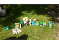 A number of gardening tools, gloves, weed killer, watering hose and others